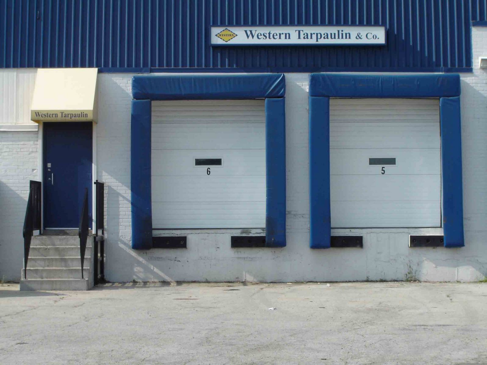 Dock bumpers and loading dock seals